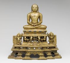 Svetambara Enthroned Jina, with Attendant Yaksha and Yakshi