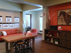 Zionsville, IN - Apartment clubhouse - I usually lean toward cool colors (blues, greys and greens) but I do like this style. It is warm and energetic, and I love the large prints of the floor plans on the wall!