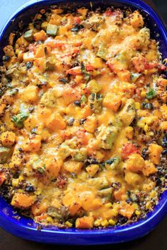 Butternut squash and other vegetables mixed together with quinoa makes a delicious vegetarian, gluten-free, and vegan friendly casserole for the whole family.