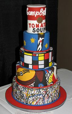 Artsy Fartsy Cake by snarkygurl, via Flickr pays tribute to Andy Warhol, Piet Mondrian, Picasso and Jackson Pollack (and one I can't identify).