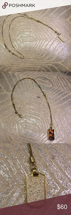 Michael Kors necklace Michael Kors long gold dog tag necklace. Barely worn, great condition! One side jeweled and other wise tortoise. Jewelry Necklaces