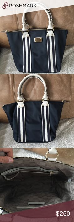 Michael Kors bag Blue and white Michael Kors bag with zip top and clean interior! Only used a couple times so still in great condition, as the pictures show. Retails for $383.00. Michael Kors Bags Shoulder Bags