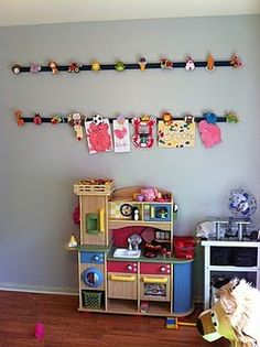 Kids' art display DIY...really need to do this!!! would look cute in the playroom or their bedroom...