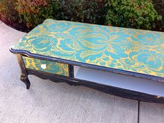 mod podge (decoupage) fabric onto a castaway coffee table