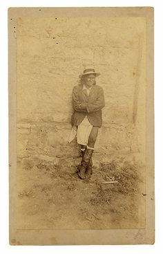 Geronimo at Fort Sam Houston, 1886: After years of conflict in the Arizona desert, Chiricahua Apache warrior Geronimo surrendered with his band. En route by train to prison in Florida, the group was held for more than a month at San Antonio's Fort Sam Houston. Here, the captive warrior wears a traditional Apache breechcloth with a dress coat, straw hat and his favorite cowboy boots. Geronimo died at Fort Sill, Oklahoma, in 1909, still a prisoner of war.