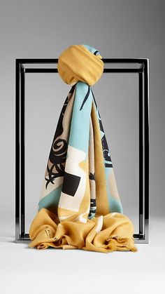 Burberry Antique Yellow The Writer Print Cashmere Scarf - A soft cashmere scarf featuring an illustrative print.  Inspired by vintage book covers, the artwork is hand-painted in our studio before being screen-printed onto lightweight cashmere.  Discover the scarves collection at Burberry.com