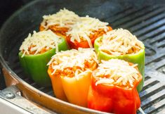 Grilled Stuffed Peppers are a delicious way to enjoy your veggies. They're stuffed with ground beef, rice, and more, and grilled to crunchy perfection. Stuffed Bell Pepers, Grilled Stuffed Peppers, Grilled Bell Peppers, Peppers And Onions, Roasted Tomato Sauce, Tomato Sauce Recipe, Canned Tomato Sauce, Grilling Recipes, Cooking Recipes