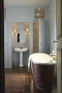 Recessed sink, separate toilet, windows above