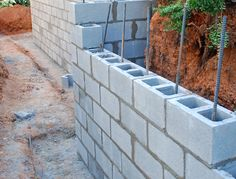 Concrete Masonry Retaining Walls | CMU Wall | Retaining Wall Companies Concrete Fence Wall, Concrete Block Retaining Wall, Backyard Retaining Walls, Rock Retaining Wall, Building A Retaining Wall, Concrete Block Walls, Cinder Block Walls, Concrete Footings, Backyard Fences
