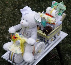 Tricycle Diaper Cake pulling a wagon filled with goodies. www.facebook.com/DiaperCakesbyDiana