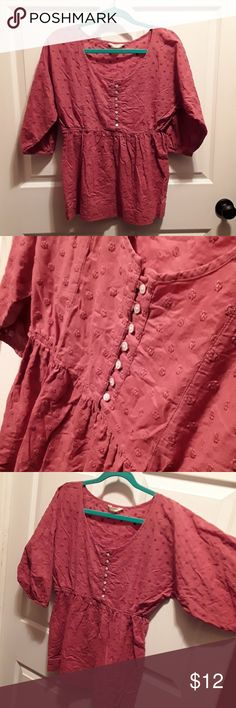 Banana Republic Rose Colored Blouse M Dusty rose colored blouse with button front and flower embroidered fabric. Cinched below the chest with elastic, allows for stretch and easy dressing and undressing since the fabric itself is not so forgiving.  Sleeves are 3/4 length and are also elastic. Gently worn (only a few times). Tag was itchy so the portion that had the size and washing instructions is cut off. Definately size Medium and normal cotton wash. Banana Republic Tops Blouses