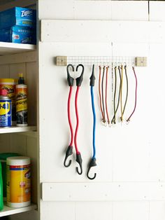 Staple each end of a 3-by-12-inch strip of hardware cloth to a 3-by-3-inch piece of scrap wood. Affix the hanger to the garage wall; hook on...