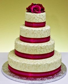Love this cake except I would want flowers going down the cake at diff angels. and maybe a diff color ribbon