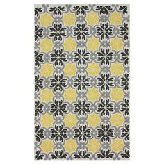 Hand-tufted rug with a tile-inspired motif.  Product: RugConstruction Material: 100% PolyesterColor: YellowFeatures: Hand-tufted Note: Please be aware that actual colors may vary from those shown on your screen. Accent rugs may also not show the entire pattern that the corresponding area rugs have.Cleaning and Care: These rugs can be spot treated with a mild detergent and water. Professional cleaning is recommended if necessary.
