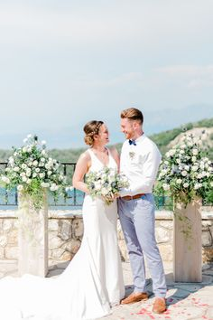 Blue and white flower filled Greek island wedding day in Meganisi, Ionian islands, Greece. At the stone paved village view point overlooking the sea. By Planner Lefkas Weddings with photographer @lefteriskalampokas