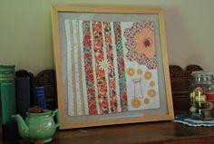 Quilt made of vintage material, framed... love, love, love!