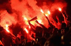 Galatasaray fans light flares during the pre-season friendly match between Notts County and Galatasaray at Meadow Lane in Nottingham