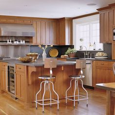This would be perfection in my dream home because everyone ends up in the kitchen anyway and it makes it a work station for more than just chopping!
