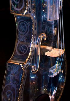 Violin - beautiful - wonder how it sounds?  Is it glass or acrylic?   VIPsAccess.com