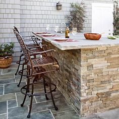 Cutured-stone veneer, brick or stucco: We explain the benefits and prices of each. | Photo: Mark Lohman | thisoldhouse.com