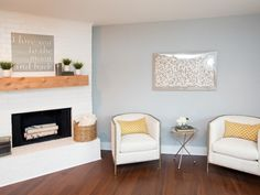 The painted fireplace and updated mantel create a clean bright focal point for the newly opened up living room.