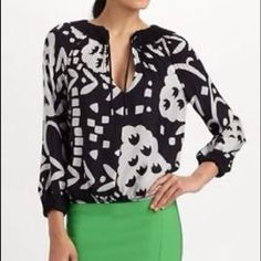 """DVF Blouse This black and white DVF blouse features accordion pleats and a drawstring at the split V neck. Gathered elastic at hem and at cuffs. Long sleeves.  * 23"""" long, measured from shoulder. * Fabrication: Crepe. * 100% polyester. * Dry clean. * Imported. Diane von Furstenberg Tops Blouses"""