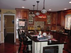 Kitchen:Beautiful Kitchen Design Idea Contemporary Home Kitchen Design Ideas With Pendant Lamp Also White Island And Black Granite Countertop Also Recessed Lighting Also Wooden Laminating Flooring Also Cabinetry