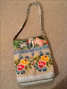 Vintage tapestry tote bag, incorporating furnishing fabric samples, lace, ribbon, and vintage and new buttons.