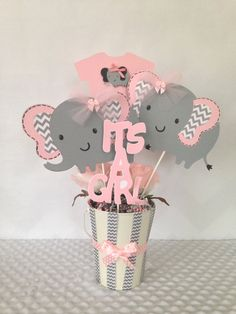 This Designer Pink and Gray Elephant Centerpiece would make the perfect Baby Shower Decoration. ***DOES NOT INCLUDE CONTAINER*** This listing includes the following items: *** 2 - Elephant Die Cuts (measure approx. 5 1/2 inches tall) *** 1 - Pink Infant Bodysuit with gray elephant embellishment ( measures approx 6 1/2 inches tall) *** 1- Its a Girl Die Cut