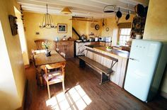 Paxton cottage rental - Kitchen with beamed ceiling, Aga cooker, Smeg Fridge Freezer & Pine Table for 8