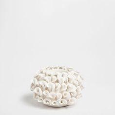 Raised white flowers tealight holder.