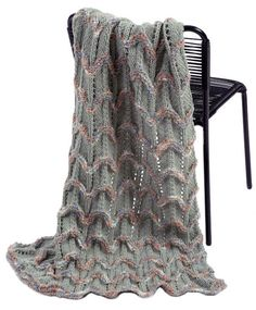 Decorator Throw in Plymouth Yarn Encore Boucle Colorspun and Encore Worsted - 1155 - Downloadable PDF. Discover more patterns by Plymouth Yarn at LoveKnitting. We stock patterns, yarn, needles and books from all of your favourite brands.