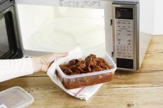 Taking food out of a clean microwave - BRETT STEVENS/Getty Images