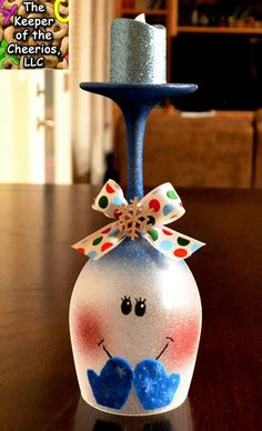 Wine glass painted into a cute little snowman