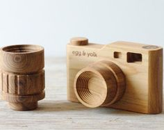 Wooden toy camera with interchangeable lens.