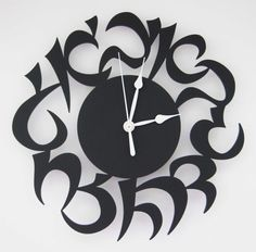 Hey, I found this really awesome Etsy listing at http://www.etsy.com/listing/101371367/hebrew-clock-black-acrylic
