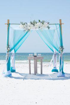 Turquoise beach wedding arbor.