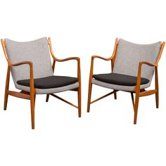 Pair of Finn Juhl NV45 Chairs by Niels Vodder   From a unique collection of antique and modern armchairs at https://www.1stdibs.com/furniture/seating/armchairs/