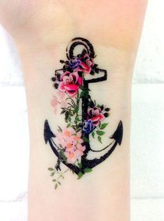 Amasing black anchor with flowers tattoo on wrist