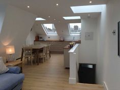 mansard loft conversion open plan living space kitchen diner