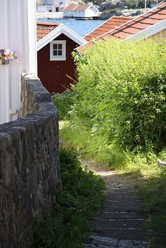 Swedish houses, path edge of a white one