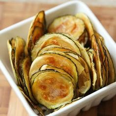 Zucchini Chips  NOTE: Cut thicker and season very conservatively. Bake at 225° for 75-90 minutes until brown. Be careful, they can burn quickly.