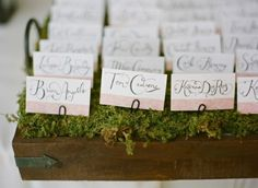 The escort card tables will both have trios of wooden boxes and vintage crates filled with moss clustered in the center of the table for the name tags.