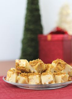 Mrs. Claus' Christmas Cookie Fudge tastes just like a Christmas cookie! It's one of the easiest fudge recipes for Christmas that you'll ever find. You won't be able to stop yourself from making it multiple times this holiday season!