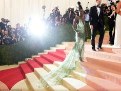 Hair-raising look: Lupita Nyong'o was a green goddess as she arrived with her locks styled up high