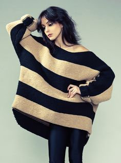 Larger sweaters make you look more petite and they are super comfortable. -EL