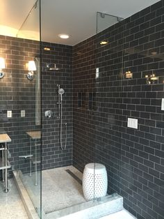 """Master bathroom remodel - Carrera marble 1"""" hexagons on the floor, Floridatile subway tile in Gunstock on the walls, garden stool in walk-in shower. Shower fixtures by Hansgrohe"""