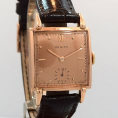 1940's Vintage Zenith Square-shape 18K Rose Gold watch with Salmon Dial with Applied Rose Roman Numeral XII and Rose Bar and Dot Markers. Triple Signed. Swiss Case Very Good Case Original, Case Dimens