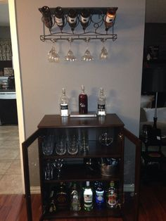 This is a sweet at home bar! The cabinet is from ikea, $85. It holds plenty of liquor bottles and glassware!