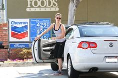 Jennifer Lawrence with her Volkswagen EOS